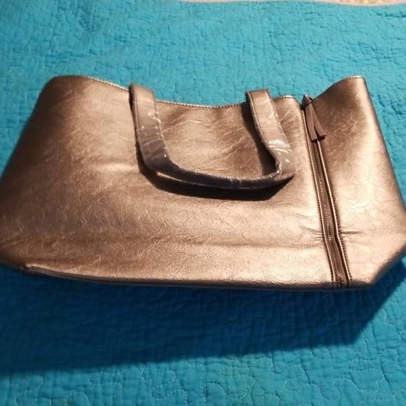 Neiman Marcus Handbags - NWOT Neiman Marcus silver tote